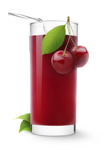 Glass of sweet cherry juice isolated on white